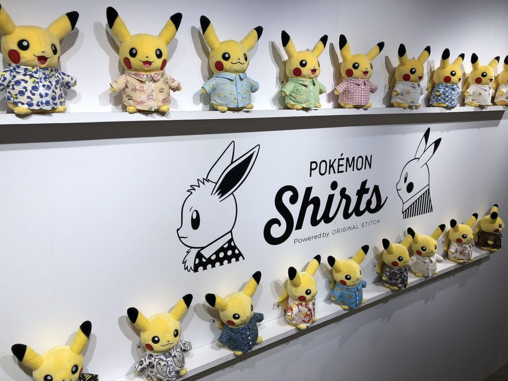 Pikachu dolls wearing different styles of Pokémon Shirts
